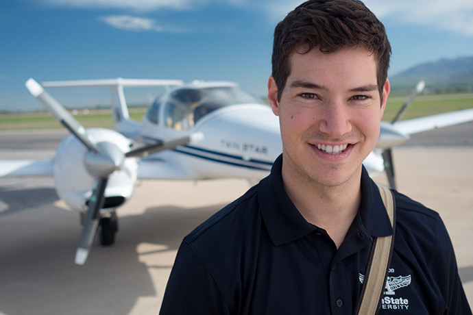 student pilot in front of a plane